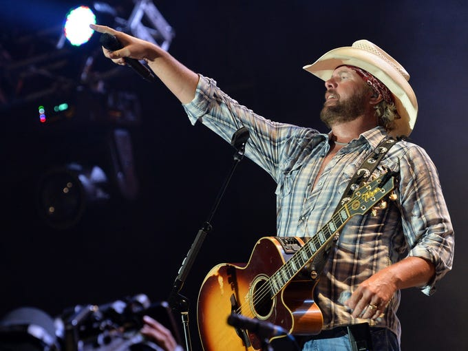 Native Oklahoman Toby Keith performs for the Oklahoma Twister Relief Concert to benefit United Way of Central Oklahoma's May Tornadoes Relief Fund Saturday in Norman, Okla. Keith was the benefit's primary organizer.