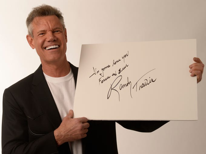 Randy Travis poses at a CMA Music Festival concert at Nashville's LP Field in June.Travis has been hospitalized in Dallas with viral cardiomyopathy. A news release from the singer's publicist says Travis was admitted to the hospital July 7.