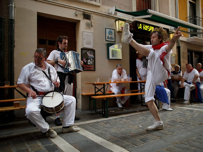 PAMPL Revellers dance while musicians from Oberena play traditional Basque Country music in the street.