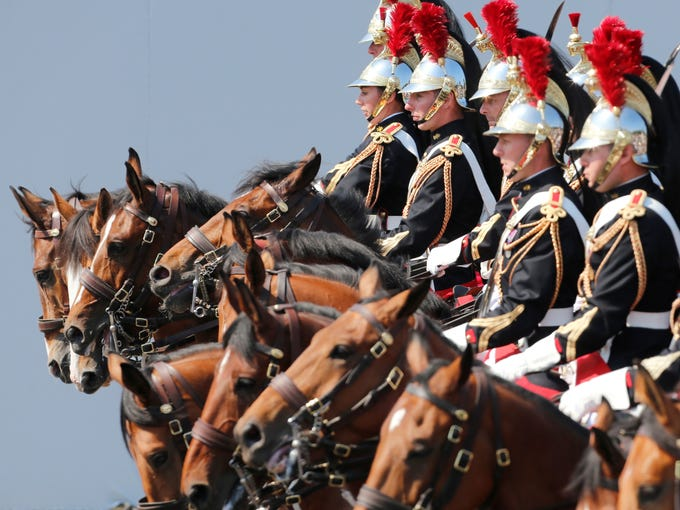 French Republican Guards parade on the Champs Elysees during Bastille Day in Paris.