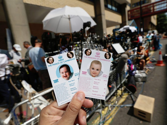 Souvenir cards showing the royal baby as either as a boy or a girl are displayed near a media area across the street from St. Mary's Hospital's exclusive Lindo Wing on July 11 in London. Members of the media are preparing for a royal birth, when Britain's Duchess of Cambridge delivers a child who will be third in line to the throne.