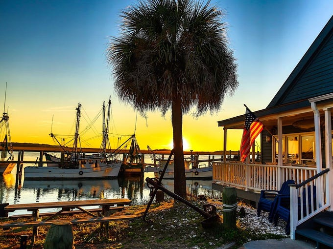 Beaufort S.C.'s downtown marina at sunset. It was proclaimed the nation's Happiest Seaside Town earlier this year, by 'coastal living' magazine. Editors cited the town's  'Lowcountry friendliness and urban refinement -- antebellum architecture, exquisite local cuisine, and rich African-American heritage.'
