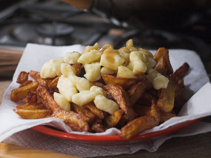 Canada -- Poutine: Originally from Quebec, poutine has infiltrated Canadian cuisine, and has crept into the U.S. as well. It traditionally consists of fries, cheese curds, and gravy, though it also comes topped with anything from Bolognese sauce to foie gras and truffles. In Montreal, two of the best versions can be found at Au Pied de Cochon and Maamm Bolduc.