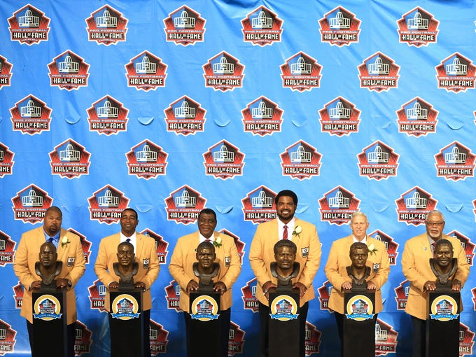 Pro Football Inductees (from left) Larry Allen, Cris Carter, Dave Robinson, Jonathan Ogden, Bill Parcells, and Curley Culp during the 2013 Pro Football Hall of Fame Enshrinement at Fawcett Stadium.