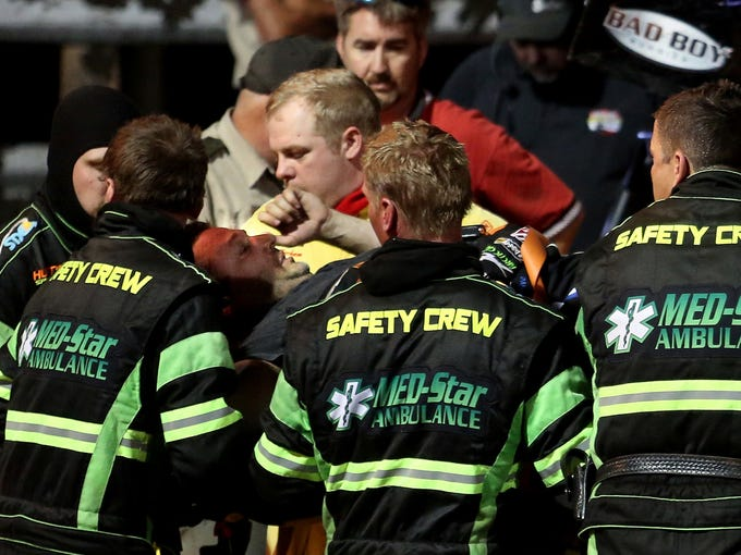 Tony Stewart is loaded into an ambulance after being involved in a four-car wreck at Southern Iowa Speedway in Oskaloosa. Stewart broke his right leg.
