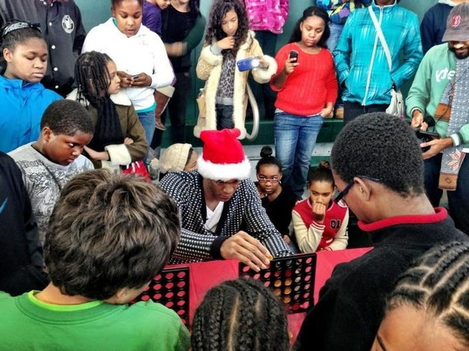 Rondo played Connect Four at the Boys & Girls Club on Dec. 22.