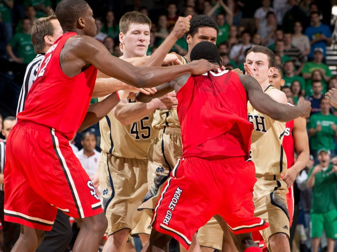 Notre Dame Fighting Irish forward Cameron Biedscheid (1) and St. John's Red Storm guard Sir'Dominic Pointer (15) get into a fight in the second half at the Purcell Pavilion. Both players were ejected.