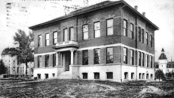 The then-new Willamette University Medical Department building is seen in 1906. The building still stands on the SE corner of Winter and State atreets. Waller Hall (left) and the first Lausanne Hall (right) can be seen in the background.