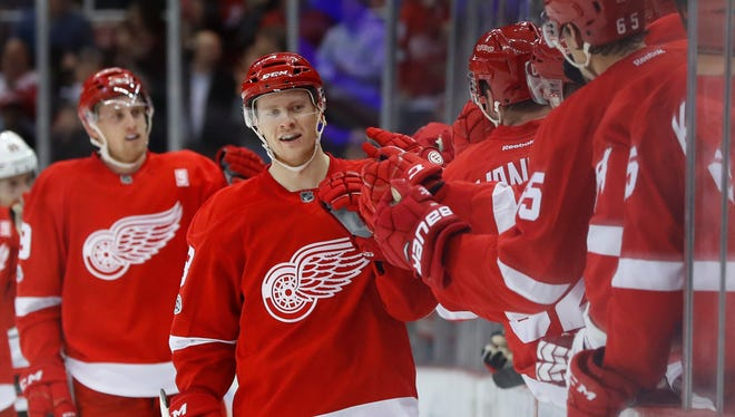 Red Wings defenseman Nick Jensen (3) celebrates his goal in the third period of the Wings' 4-3 loss to the Devils Tuesday at Joe Louis Arena.