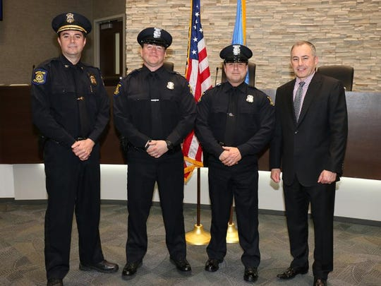 Westland Police Chief Jeff Jedrusik (left), new officers Kristopher Landis and Shawn Davidson, and Westland Mayor William Wild.