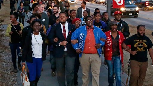 University of Oklahoma students march to the now closed University of Oklahoma's Sigma Alpha Epsilon fraternity house  during a rally in reaction to an incident in which members of a fraternity were caught on video chanting a racial slur, in Norman, Okla., Tuesday, March 10, 2015. (AP Photo/Sue Ogrocki)