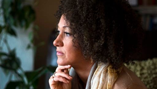 FILE- In this March 2, 2015 file photo, Rachel Dolezal, president of the Spokane chapter of the NAACP, poses for a photo in her Spokane, Wash. home. Dolezal is facing questions about whether she lied about her racial identity, with her family saying she is white but has portrayed herself as black, Friday, June 12, 2015.
