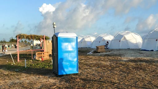 "This photo provided by Jake Strang shows tents and a portable toilet set up for attendees for the Fyre Festival, Friday, April 28, 2017 in the Exuma islands, Bahamas. Organizers of the much-hyped music festival in the Bahamas canceled the weekend event at the last minute Friday after many people had already arrived and spent thousands of dollars on tickets and travel. A statement cited ""circumstances out of our control,"" for their inability to prepare the ""physical infrastructure"" for the event in the largely undeveloped Exumas. (Jake Strang via AP)"