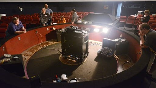 Technicians install a new digital projection system at the Russell C. Davis Planetarium in Jackson on June 10, 2014.  The new digital projection system brings full dome digital cinema to the state?s largest screen and represents a stellar upgrade for the 1978 facility.