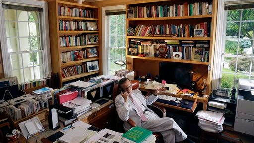 Rutgers professor Hooshang Amirahmadi sits in his office at his home July 9 in Princeton, N.J. An online magazine reported Wednesday that the National Security Agency and the FBI covertly scanned the emails of Amirahmadi and four other prominent Muslim-Americans under the U.S. government's secret surveillance program aimed at foreign terrorists and other national security threats. The magazine identified the targeted Muslim-Americans as lawyer Asim Ghafoor, Republican operative Faisal Gill, Rutgers University professor Hooshang Amirahmadi, activist Agha Saeed and Nihad Awad, executive director of the Council of American-Islamic Relations, a Muslim civil rights group.