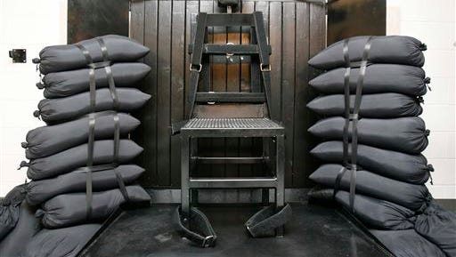 FILE - In this June 18, 2010, file photo, the firing squad execution chamber at the Utah State Prison in Draper, Utah, is shown. In the wake of a bungled execution in Oklahoma last month, a Utah lawmaker wants to resurrect firing squads as a method of execution in his state. Rep. Paul Ray, a Republican from Clearfield, says firing squads would be a quick and humane way to put someone to death as lawsuits and drug shortages have hampered lethal injections in recent years. Ray plans to introduce his proposal during Utah?s next legislative session in January. Utah stopped allowing death-row inmates to choose execution by firing squad after 2004. Several inmates sentenced before that time have opted for firing squad executions but are appealing their sentences. Utah last used the method in 2010, when a firing squad of five police officers with .30-caliber Winchester rifles executed Ronnie Lee Gardner.