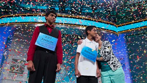Ansun Sujoe, 13, of Fort Worth, Texas, left, and Sriram Hathwar, 14, of Painted Post, N.Y., celebrate as they wait for the rest of their families to join them on stage after being named co-champions of the National Spelling Bee, on Thursday, May 29, 2014, in Oxon Hill, Md. (AP Photo/Evan Vucci)