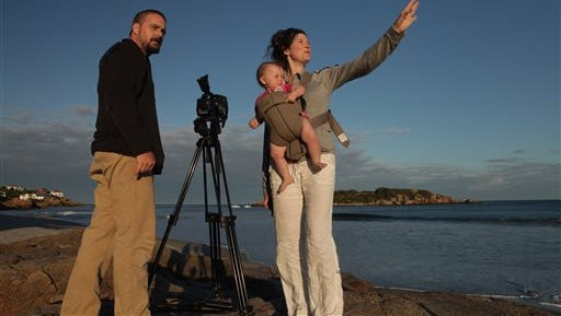 """This undated photo provided by PBS shows, from left, Banker White, Anna Fitch and Dylan Tilly White. Banker White returned to his Massachusetts family home in 2009 to be a good son to his 61-year-old mother, newly diagnosed with Alzheimer's disease. White's skill as a filmmaker allowed him to do even more: enrich his mom's life; document family history and his father's devotion, and illustrate the disease's toll. His documentary film, """"The Genius of Marian,"""" airs Sept. 8, 2014, on PBS' """"POV"""" independent non-fiction film showcase (check local listings). The film, a surrogate for an unfinished book, was directed by White and co-directed and produced by Anna Fitch, his wife."""