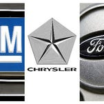 In this combo made with file photos, logos for the Big Three automobile manufacturers, General Motors, Chrysler and Ford, are shown.