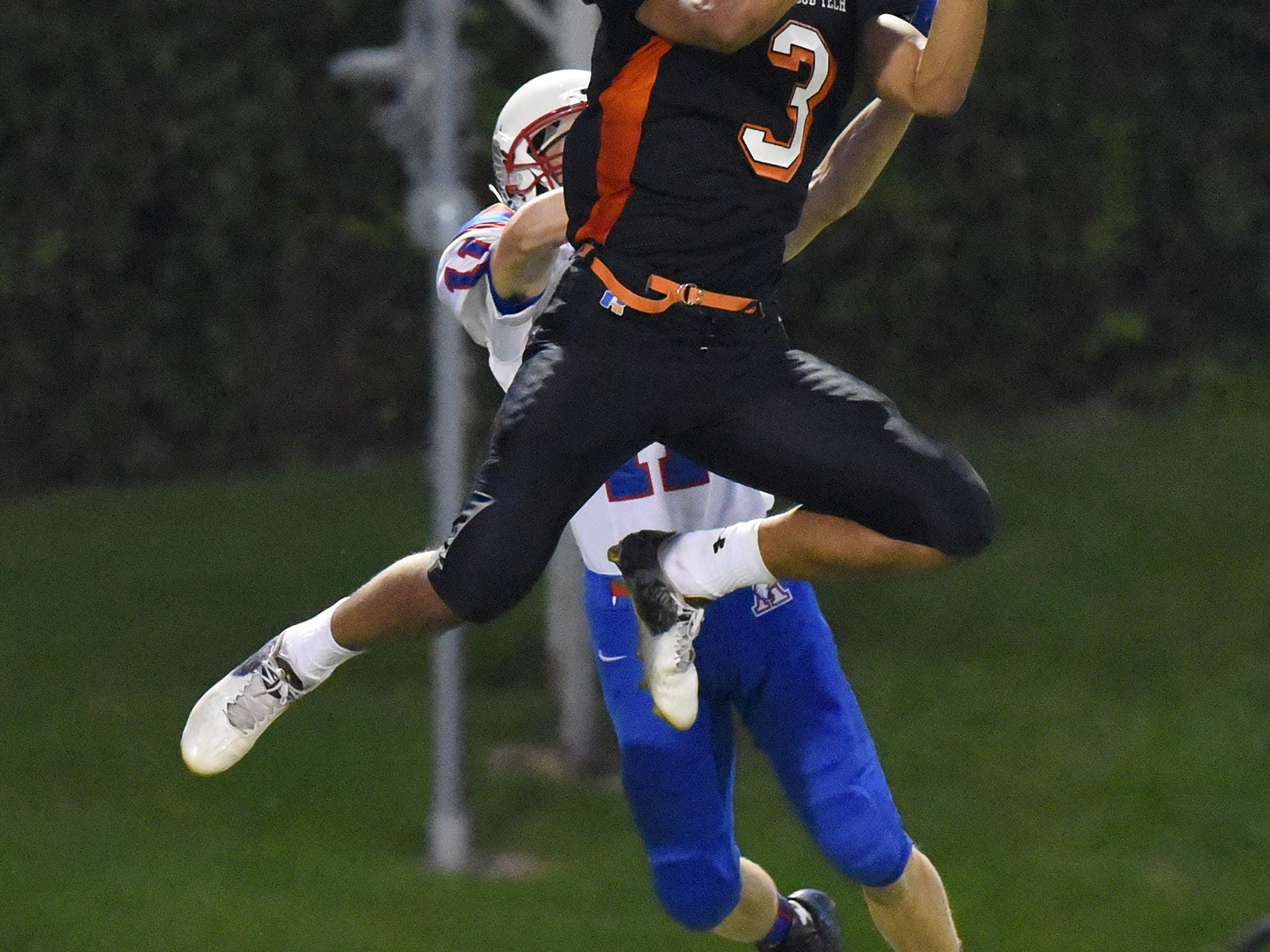 St. Cloud Tech's Brevyn Spann-Ford leaps for a reception during the first half of Friday's game at Husky Stadium in St. Cloud.