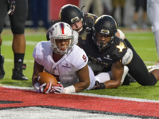 Cajuns running back Trey Ragas dives into the endzone for a touchdown as Louisianas Ragin Cajuns take on the Texas State Bobcats at Cajun Field. Thursday, Oct. 12, 2017.