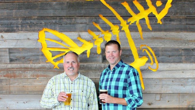 Flying Fish Founder Gene Muller, left, and incoming President Lou Romano stand in the brewery in Somerdale. Romano will take the helm on Nov. 20.