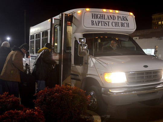FILE: Participants in the Room in the Inn program, which provides overnight shelter for homeless men at local churches, board the Highland Park Baptist Church bus Jan. 7, 2014, outside of Area Relief Ministries in downtown Jackson.
