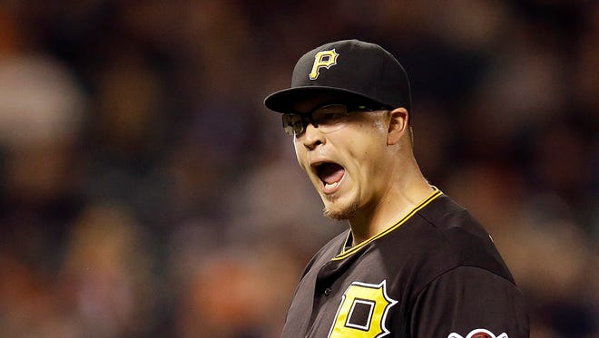 Pittsburgh Pirates pitcher Vance Worley celebrates after the 5-0 defeat of the San Francisco Giants at the end of a baseball game.
