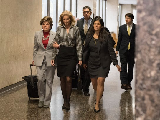 Photo shows Summer Zervos, center, arriving in Manhattan