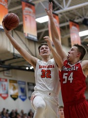 Kaukauna's Dylan Kurey (32) puts up a shot against