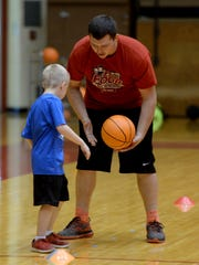 Tanner Coyle helps a participant of a Richmond High
