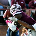 Mississippi State Bulldogs wide receiver De'Runnya Wilson (1) comes down with a pass in the end zone as he is defended by Troy Trojans cornerback Jalen Harris (19) at Davis Wade Stadium. Mandatory Credit: Matt Bush-USA TODAY Sports