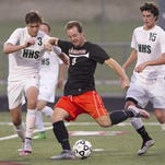 Micah Charlick, center, and the Brighton soccer team defeated Milford, 1-0, on Tuesday night.