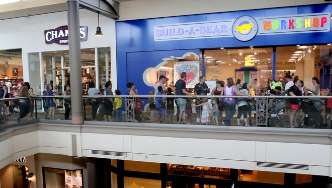 Long lines wandered through the second level of Mayfair Mall as people waited to enter Build-A-Bear for its Pay Your Age deal on July 12. One mother said she joined the line with her children at 8:30 a.m. only to enter the store three hours later.
