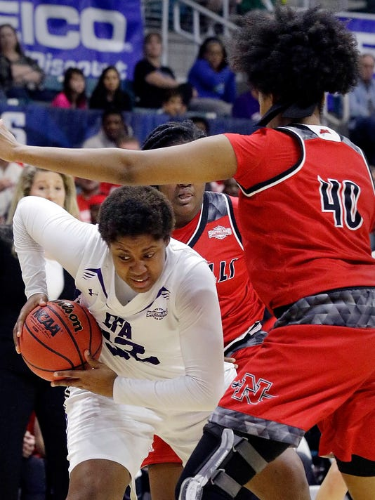 Stephen F. Austin forward Imani Johnson, left, looks for a way between Nicholls guard Destiny Collins, center, and center Marina Lilly (40) during the first half of an NCAA college women's basketball game in the Southland Conference tournament championship Sunday, March 11, 2018, in Houston. (AP Photo/Michael Wyke)