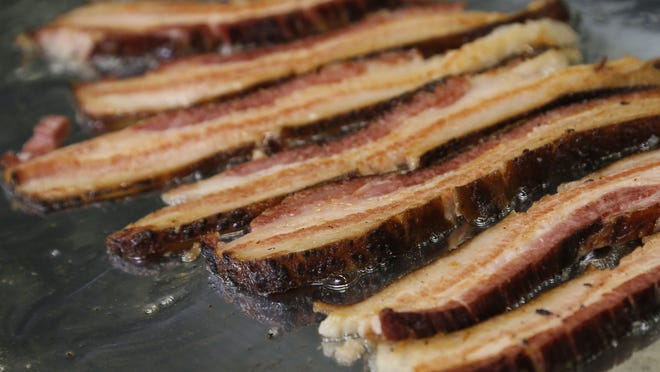 """The New Hampshire has released its first scratch-n-sniff """"I Heart Bacon"""" ticket, which features a $1,000 grand prize."""