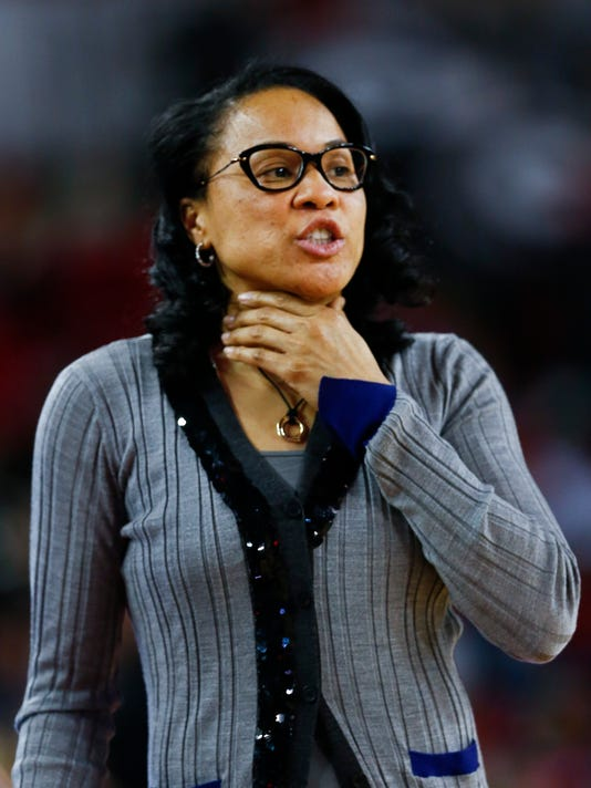 South Carolina head coach Dawn Staley yells from the sideline in the second half of an NCAA college basketball game  against Georgia Thursday, Feb. 5, 2015, in Athens, Ga.  South Carolina won 58-35. (AP Photo/John Bazemore)
