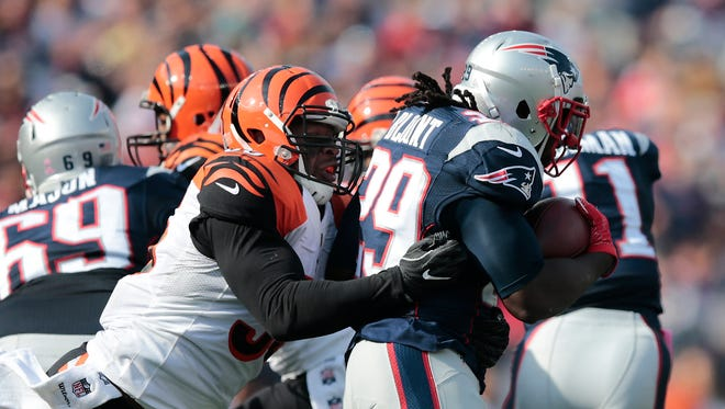 Bengals outside linebacker Vontaze Burfict tackles Patriots running back LeGarrette Blount in the second quarter of Sunday's loss in New England.