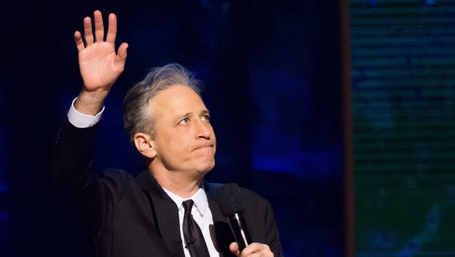 "In this Feb. 28, 2015 file photo, Jon Stewart appears onstage at Comedy Central's ""Night of Too Many Stars: America Comes Together for Autism Programs"" in New York."