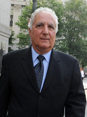 June 21, 2011 file photo shows former Bernard Madoff operations director Daniel Bonventre leaving New York City's Manhattan federal court after a hearing before the fraud trial against him and four former co-workers.