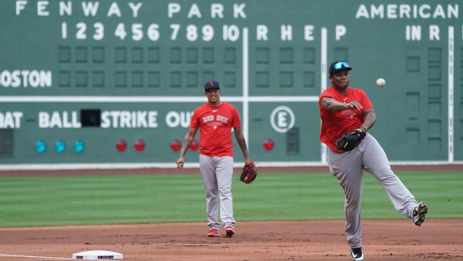 Red Sox third baseman Rafael Devers throws the ball during a drill Wednesday at Fenway Park.