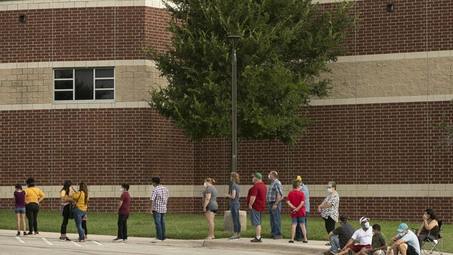 People wait in line for COVID-19 tests at the Hays CISD Performing Arts Center in Kyle on June 27. The free walk-up testing site was conducted by the Texas Division of Emergency Management and the Texas Army National Guard in collaboration with the Hays County Office of Emergency Management.