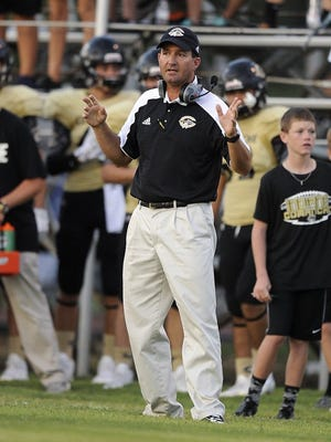 Thomas Metthe/Reporter-News Comanche head coach Stephen Hermesmeyer yells instruction to his players during the first quarter of Comanche's 24-10 loss to Coleman on Friday, Sept. 2, 2016, at Hufford Field in Coleman.