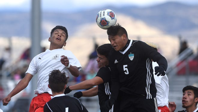 North Valleys' Erick ceja Gonzalez (5) heads the ball during the Northern Region Boy's Soccer championship game against Wooster at Spanish Springs on Nov. 4, 2017.