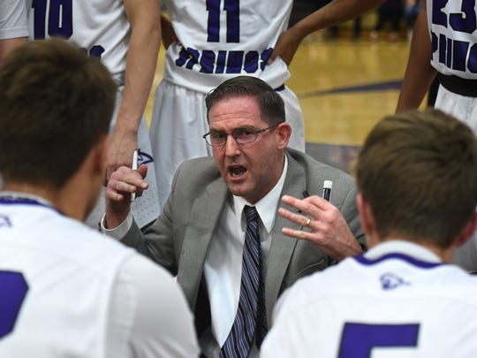 Spanish Springs high basketball head coach Kyle Penney talks with his team during a time out in a recent home game.