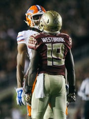 A.J. Westbrook (19) exchanges words with a Florida