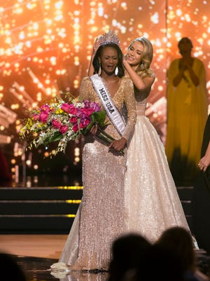 Miss District of Columbia Deshauna Barber is crowned Miss USA by Miss USA 2015 Olivia Jordan on Sunday during the 2016 Miss USA pageant in Las Vegas.
