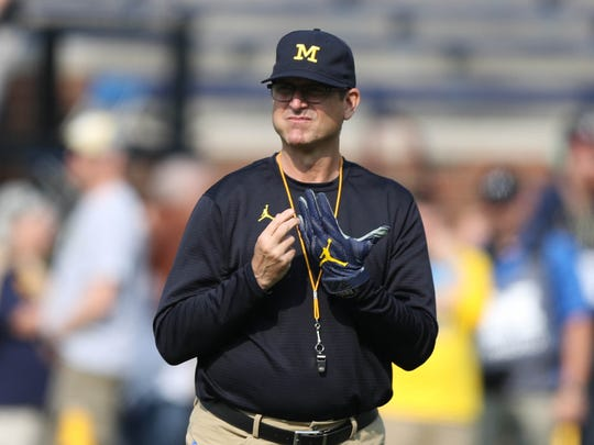 Michigan head coach Jim Harbaugh watches his team warm up before action against Air Force, Saturday, Sept. 16, 2017 at Michigan Stadium.