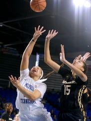 MTSU's Alex Johnson (00) goes up for a shot as Southern