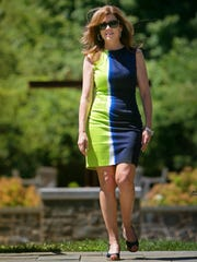 Jane Rubini wears a blue and green cotton shift dress by Tahari, found at Marshall's, with navy patent espadrilles by Andre Assous, purchased at Peter Kate's in Greenville.